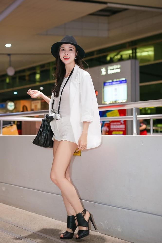 Vũ Ngọc Anh khoe chân dài gợi cảm ở sân bay - ảnh 5