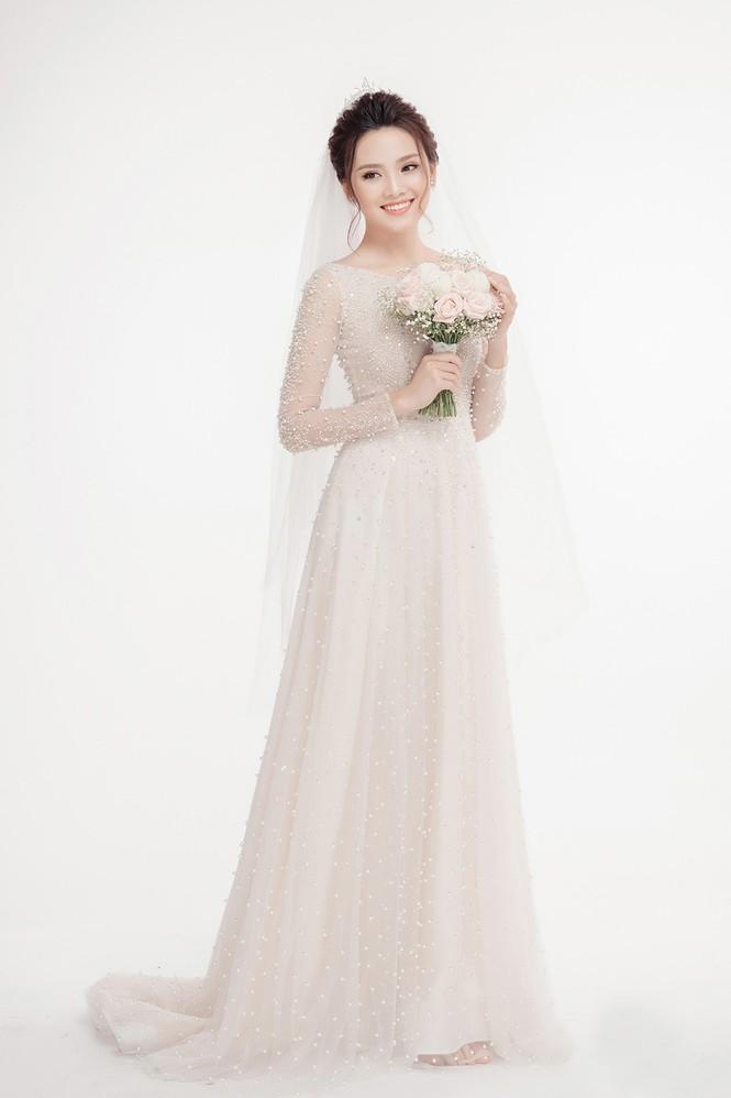 Ảnh cưới lung linh của Top 10 HHVN Tố Như và 'hot boy cảnh sát' - ảnh 6