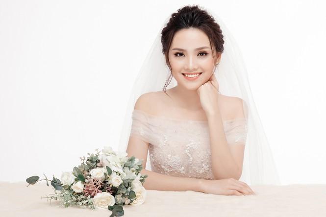 Ảnh cưới lung linh của Top 10 HHVN Tố Như và 'hot boy cảnh sát' - ảnh 10