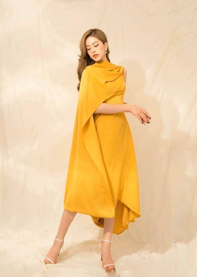 Hoa hậu Lương Thuỳ Linh khoe vòng một gợi cảm với váy trễ vai đỏ rực - ảnh 7