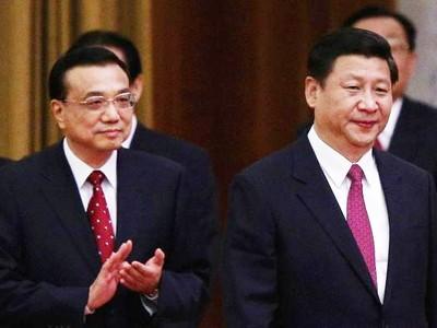 Phó Chủ tịch nước Tập Cận Bình (phải) và Phó Thủ tướng Lý Khắc Cường.             Ảnh: China Daily