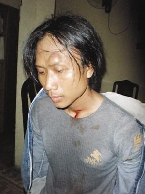 Hung thủ Cao Quốc Huy sau khi bị bắt giữ