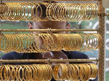Quỹ đầu tư tín thác vàng lớn nhất thế giới hôm qua bán ra lần đầu tiên sau một tuần. Ảnh: Reuters
