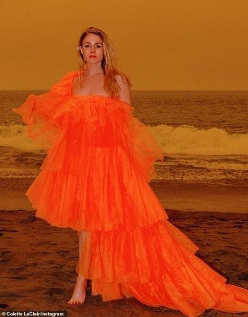 Chụp ảnh với bầu trời màu cam do cháy rừng để bán váy màu cam: Vô duyên hay nghệ thuật? - ảnh 1