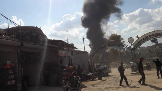 Hiện trường vụ nổ bom xe ở Syria khiến gần 100 nguời thương vong - ảnh 1
