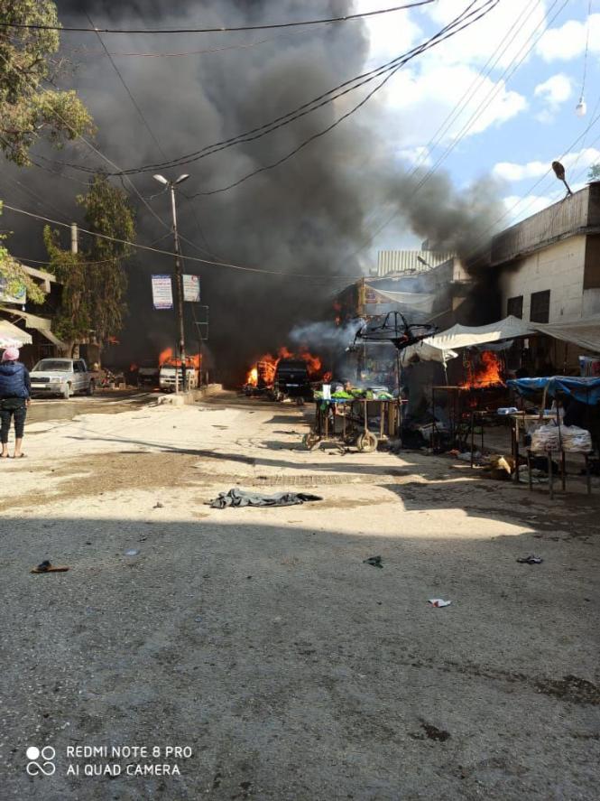 Hiện trường vụ nổ bom xe ở Syria khiến gần 100 nguời thương vong - ảnh 2