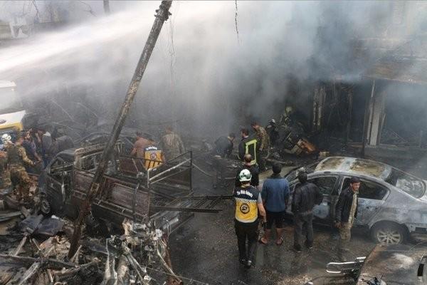 Hiện trường vụ nổ bom xe ở Syria khiến gần 100 nguời thương vong - ảnh 3