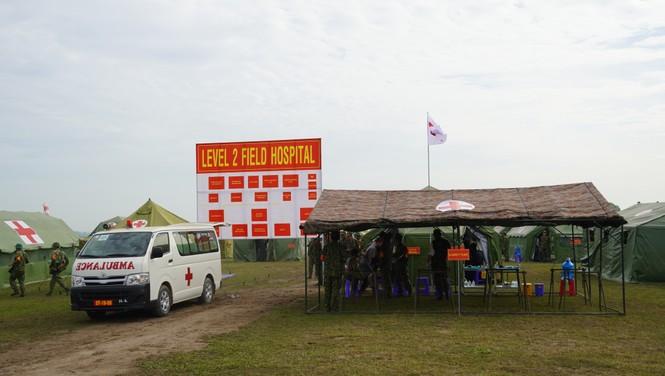 Binh sĩ và người dân Việt Nam và Campuchia diễn tập cứu nạn tại biên giới - ảnh 9