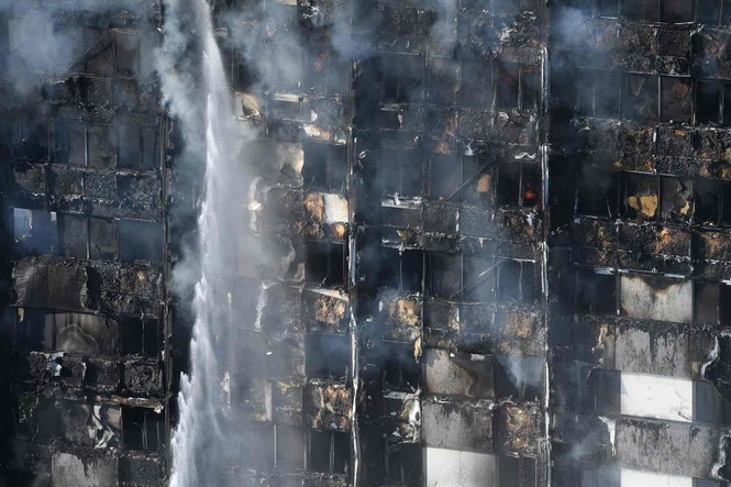 Những người thoát khỏi tòa nhà cháy rụi kể lại giây phút kinh hoàng - ảnh 9