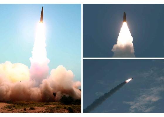 Ông Kim Jong-un cười tươi khi quân đội phóng tên lửa thành công - ảnh 10