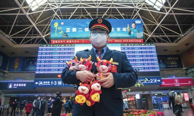 Người Trung Quốc bắt đầu cuộc di cư hàng năm lớn nhất thế giới - Ảnh 3.