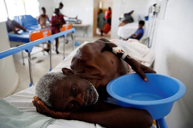 Cảnh tan hoang như thời chiến ở Haiti sau bão Matthew - ảnh 9