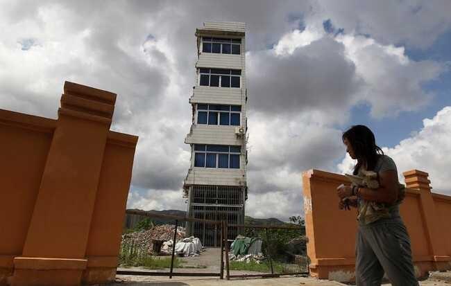 Những ngôi nhà 'vô duyên' giữa đường, có tiền cũng khó phá - ảnh 9