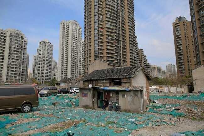 Những ngôi nhà 'vô duyên' giữa đường, có tiền cũng khó phá - ảnh 15