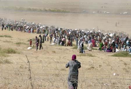 60.000 người tị nạn Syria chạy sang Thổ Nhĩ Kỳ trong 1 ngày - ảnh 1