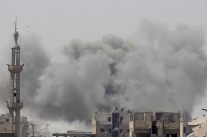 Người dân Raqqa liều chết bỏ trốn khỏi IS giữa bom đạn giao tranh - ảnh 1