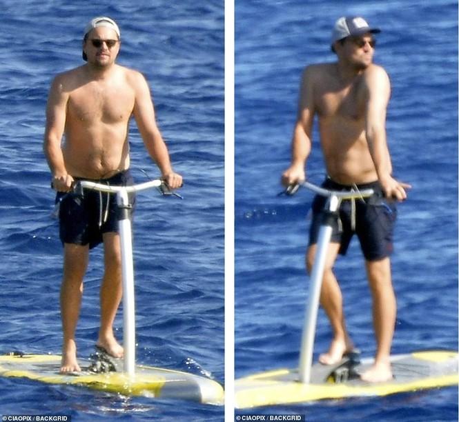 'Ông chú bụng bia' Leonardo DiCaprio nữ tính, bạn gái 9x lướt ván điệu nghệ - ảnh 6