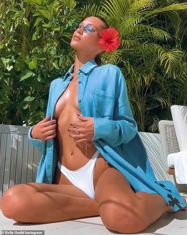 Bella Hadid phanh áo lộ vòng một 'thả rông', ngồi yên cũng vô cùng sexy - ảnh 5