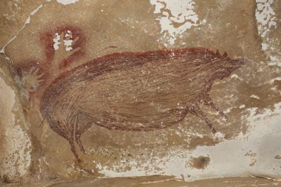 Phát hiện bức tranh hang động cổ xưa nhất thế giới - ảnh 1